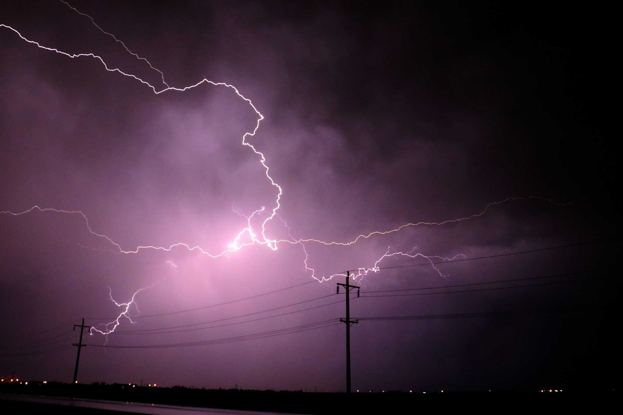 Lightning Strikes and electricity pole in background
